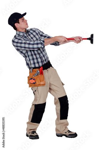 Handyman pulling a plunger