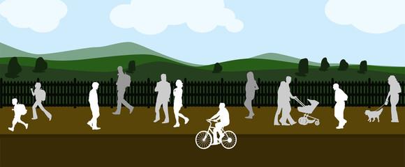 Gente paseando con el campo de fondo