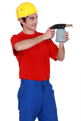 Tradesman holding a blowtorch