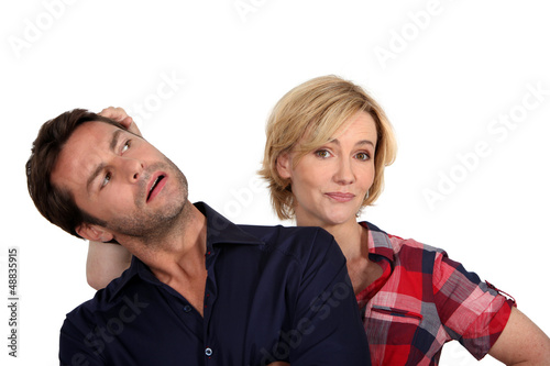 Wife pushing husband's head