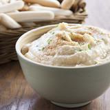 Chickpea hummus bowl with bread sticks