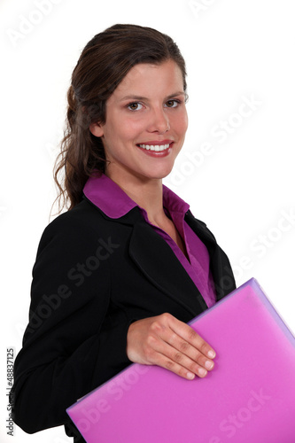 Woman carrying purple folder
