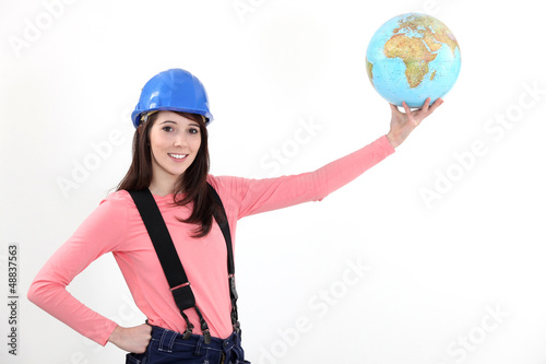 Female manual worker holding globe