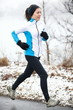 Woman jogging in a snowy landscape