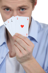 Man with four ACES