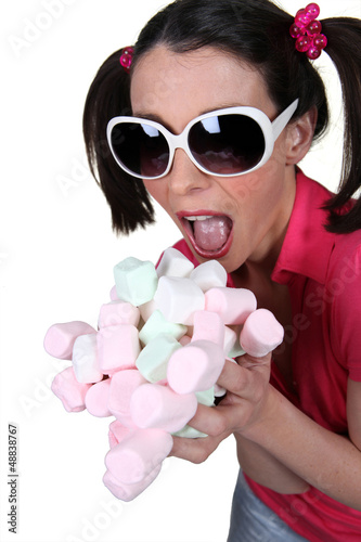 Girl going crazy for marshmallows
