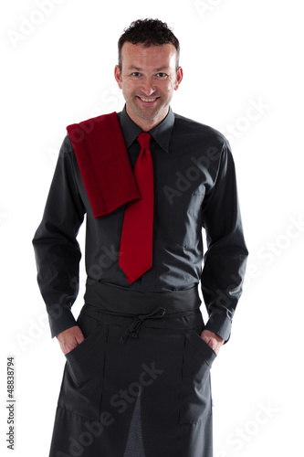Server wearing black shirt and apron