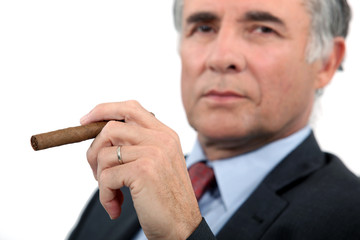 Senior businessman with cigar