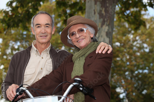 Elderly couple on a bike ride in the forest