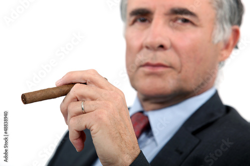 Senior businessman with cigar