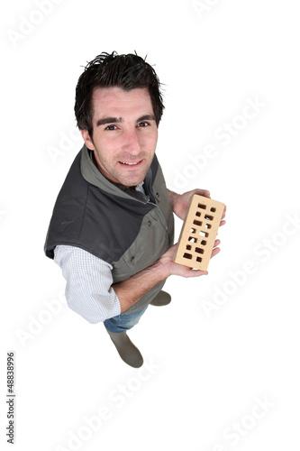Handyman holding a brick