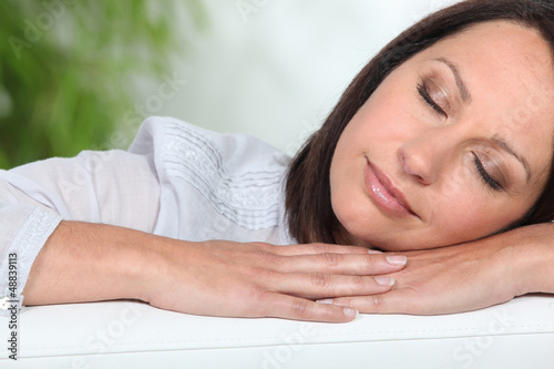 Woman asleep on a sofa