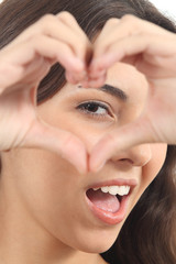 Beautiful woman making a heart shape