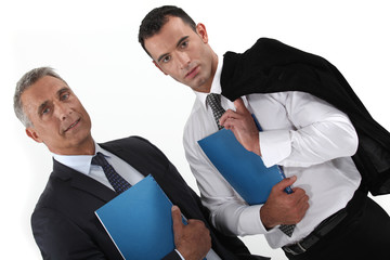 Businessmen holding folders