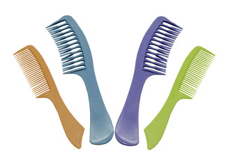 variety of hair combs on a white background