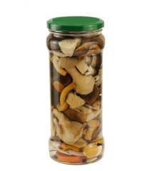 marinated mushrooms in a glass jar, isolated