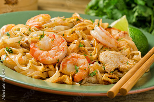 Pad Thai Garnished with Cilantro and Lime