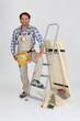 Carpenter with a stepladder and wooden shutter