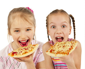 Young girls preparing homemade pizza