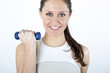 Young woman lifting dumbbells during
