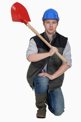 Man with spade kneeling