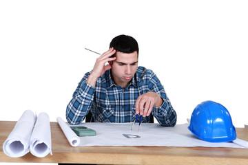 architect in office having a headache