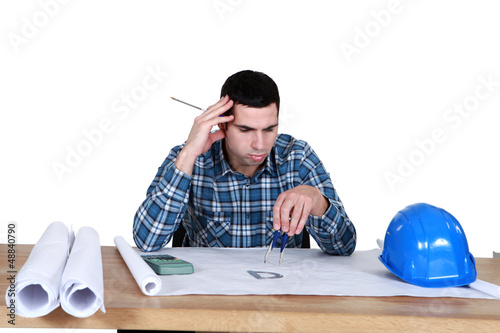 architect in office having a headache
