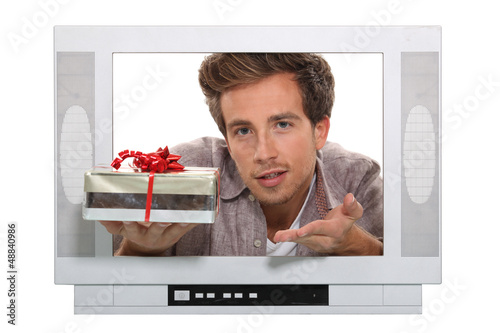 Man passing through TV screen