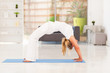 mature woman doing yoga at home