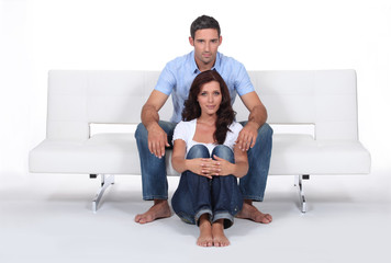 portrait of couple posing on sofa