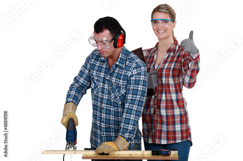 Woman inspecting carpenter