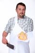 Butcher holding chicken