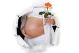 Pregnant woman holding flower
