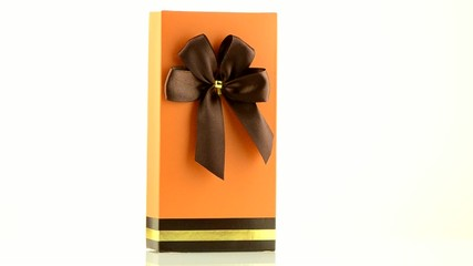 Orange box with gold bow