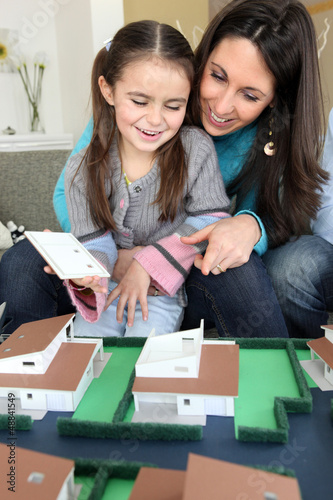 female architect at home with young daughter