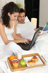 couple eating breakfast in hotel room