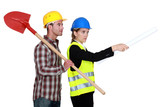 Building worker and woman supervising work on white background