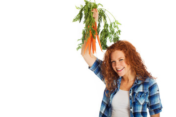 proud woman with farm fresh carrots