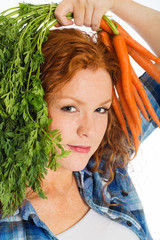 cute redhead with fresh carrots