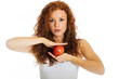 Pretty woman balancing an apple