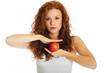 Pretty woman balancing an apple