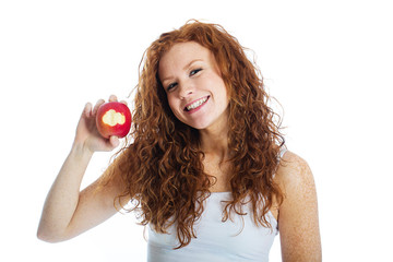 Woman taking a bite out of an apple