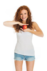 Happy woman holding an apple