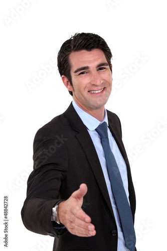 Businessman offering you his hand