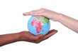 Two hands touching miniature globe