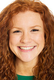 happy woman with red hair and freckles