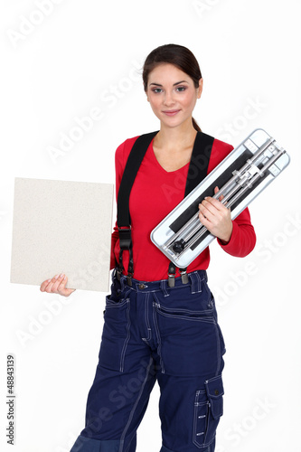 Craftswoman holding a tile