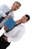 Two businessmen observing folder