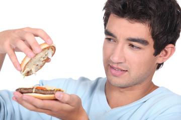 Man opening a hamburger