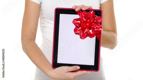 Woman giving Tablet PC gift